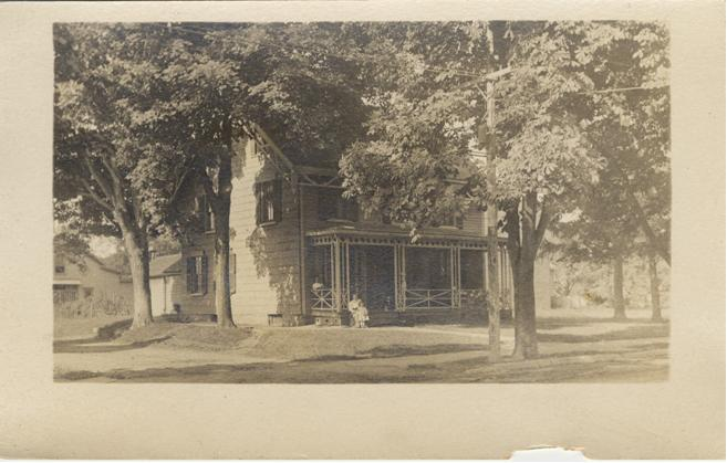 Photograph of a house and trees