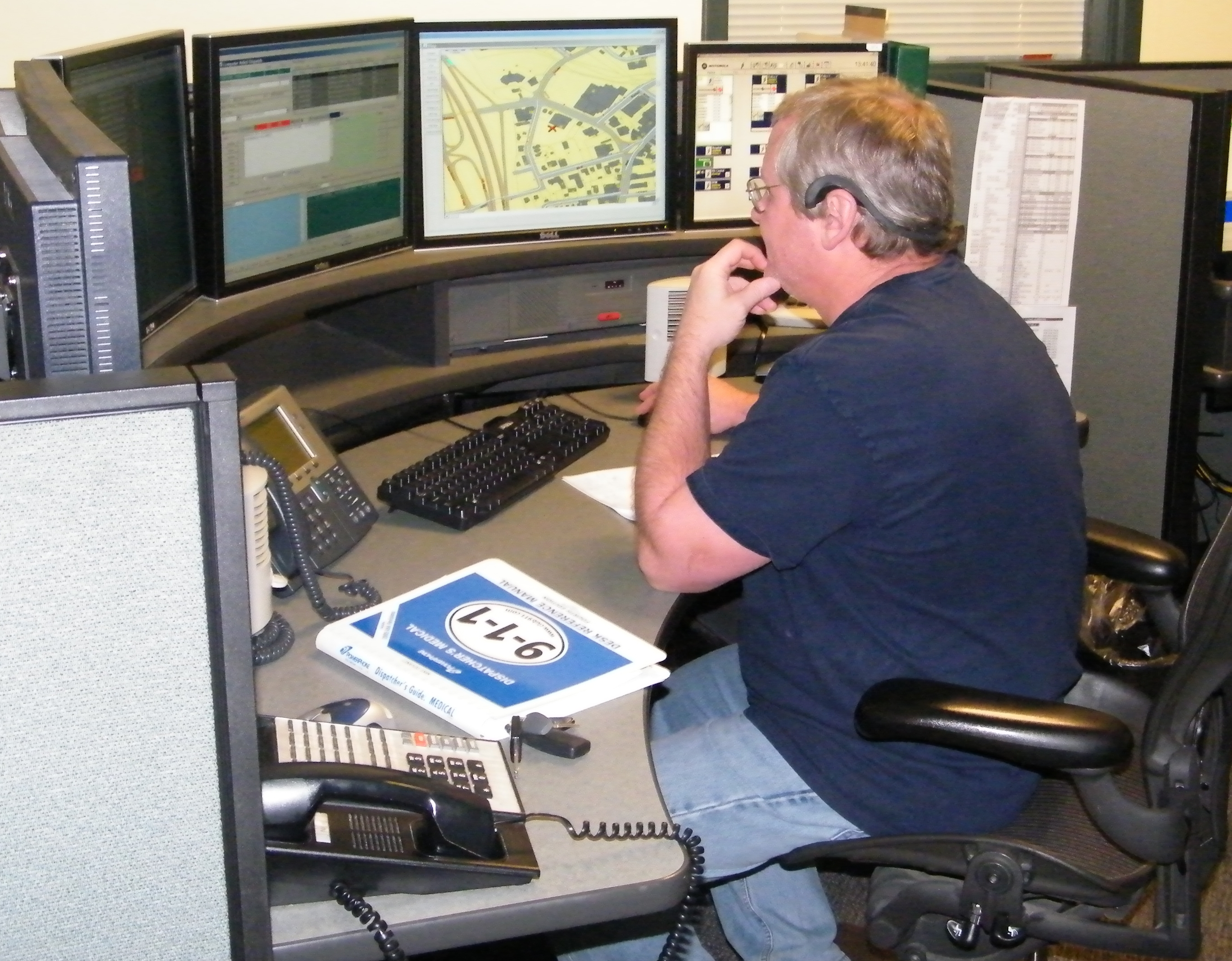 Combined Dispatch employee at a work station