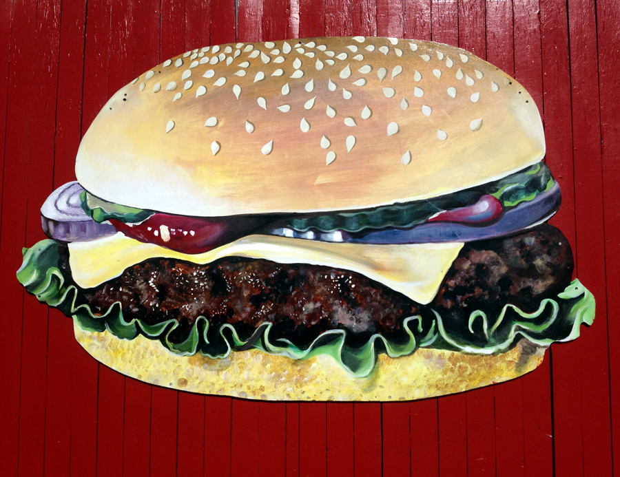 Hamburger painted on red wall